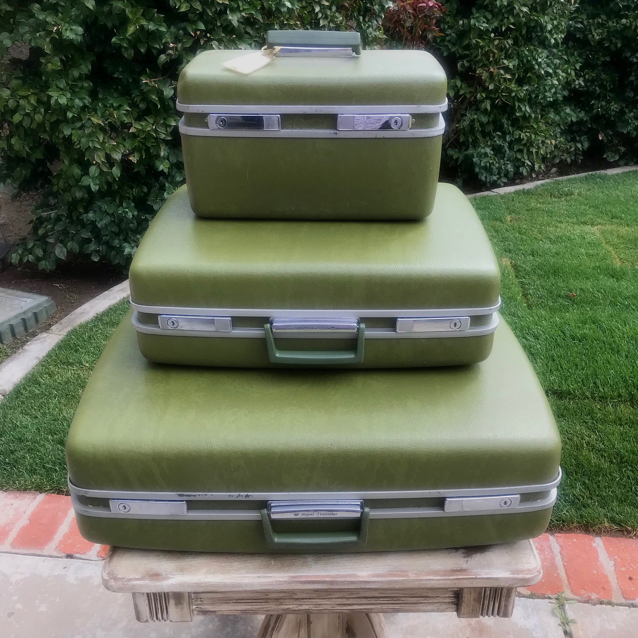 Green Vintage Suitcases   Three different sizes.