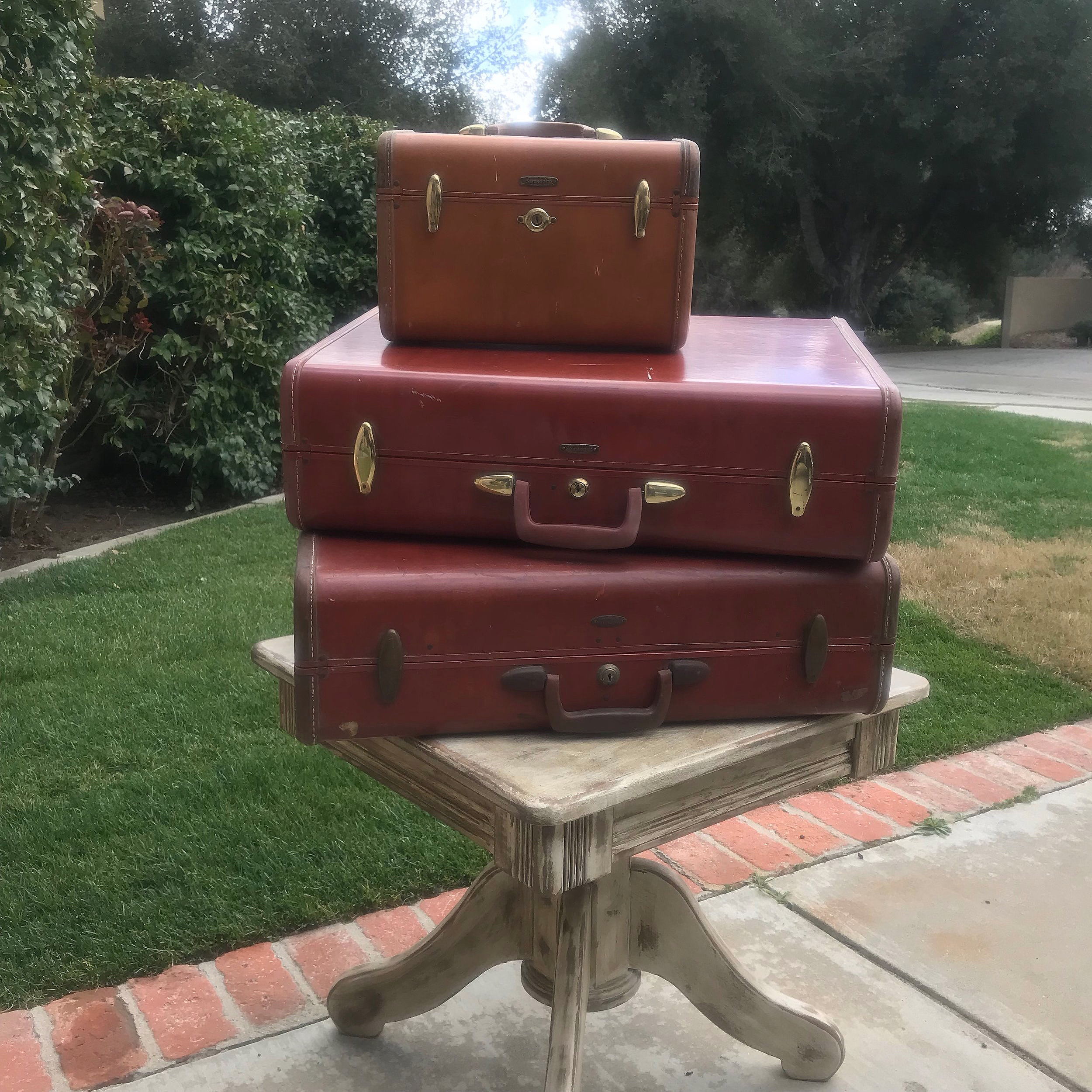 Brown Vintage Suitcases   Three different sizes.