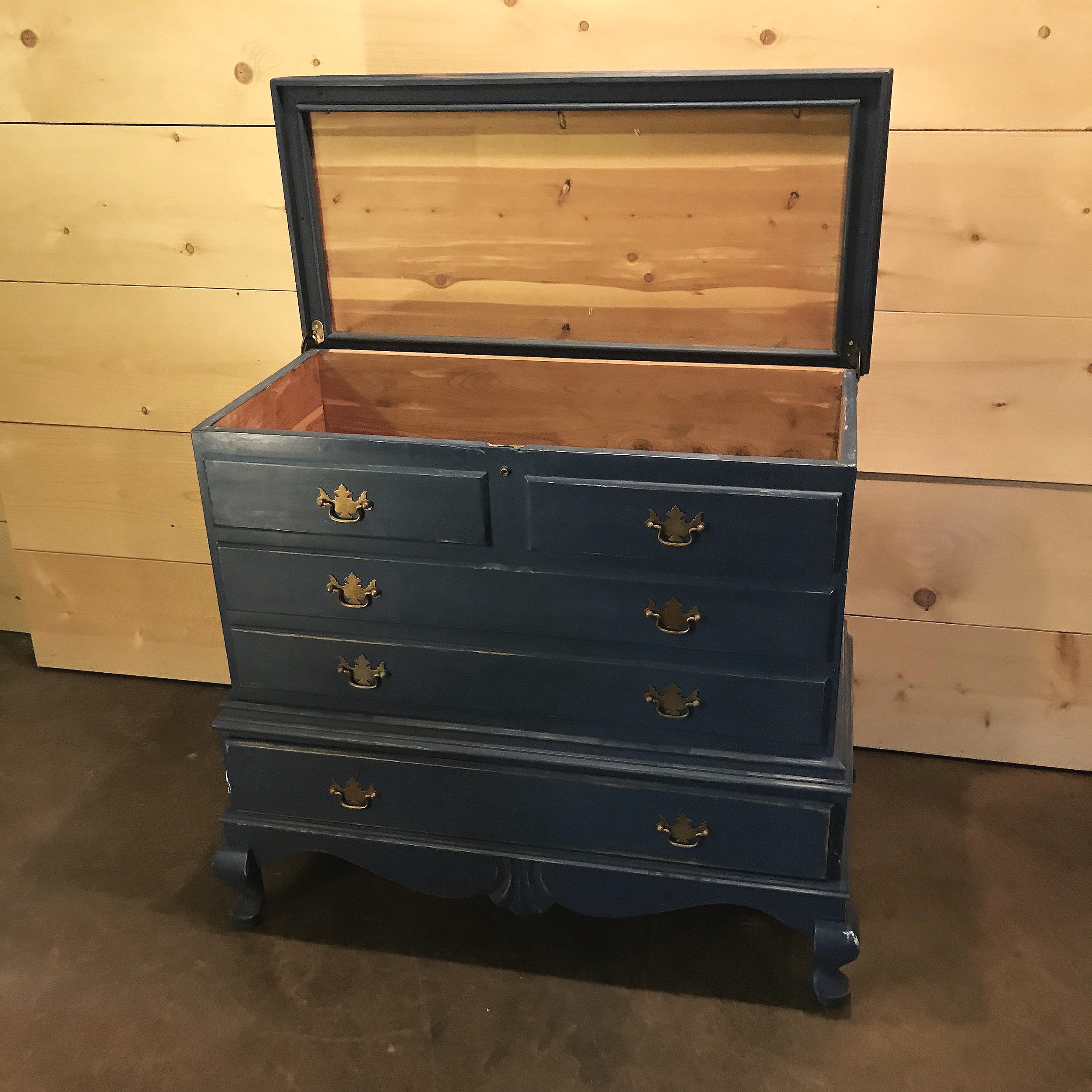 Chalk painted navy blue tall cedar chest with lid that opens.
