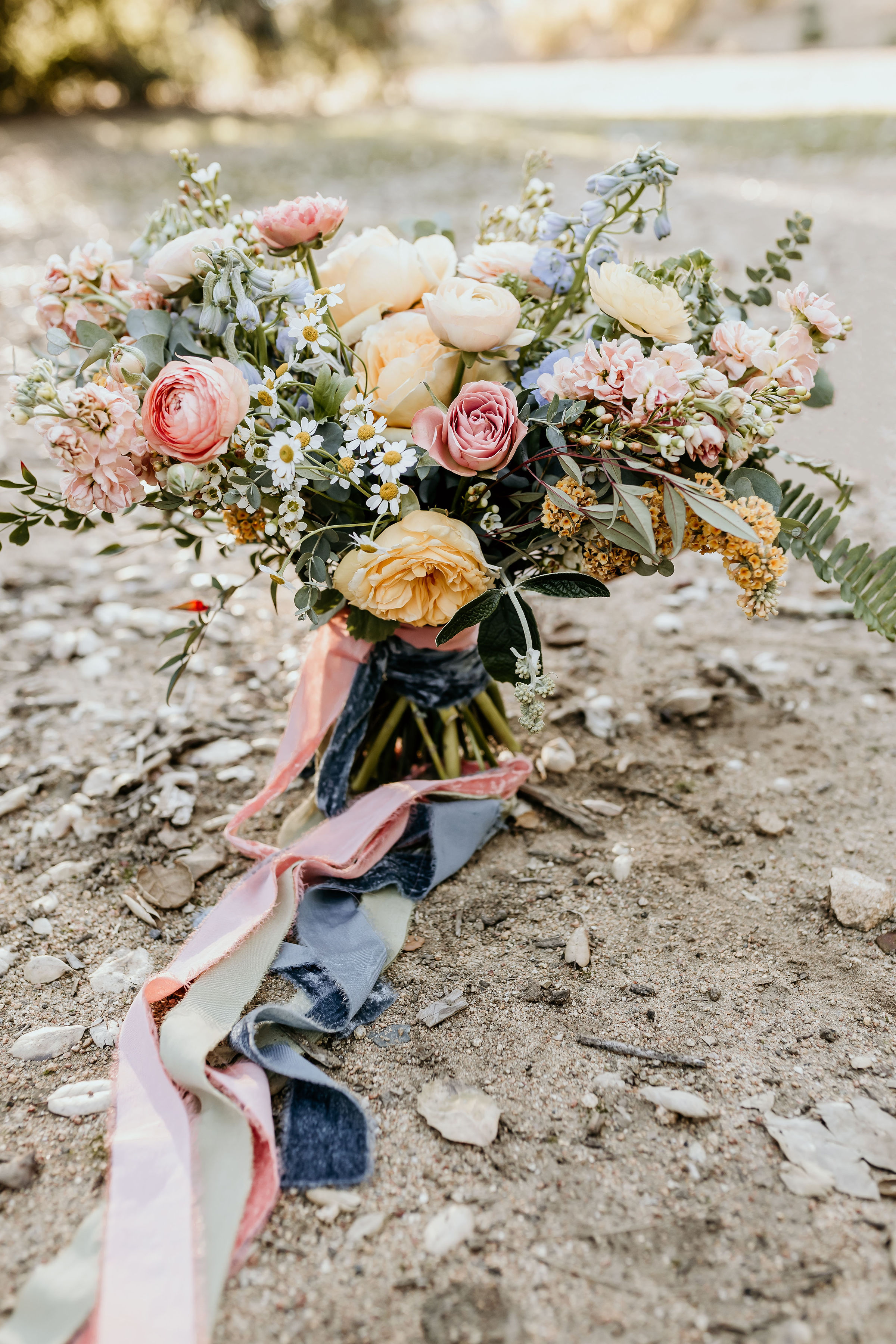 Vintage pink and pastel floral bridal bouquet used at the Alice in Wonderland styled shoot at Chateau Adare in Murrieta.