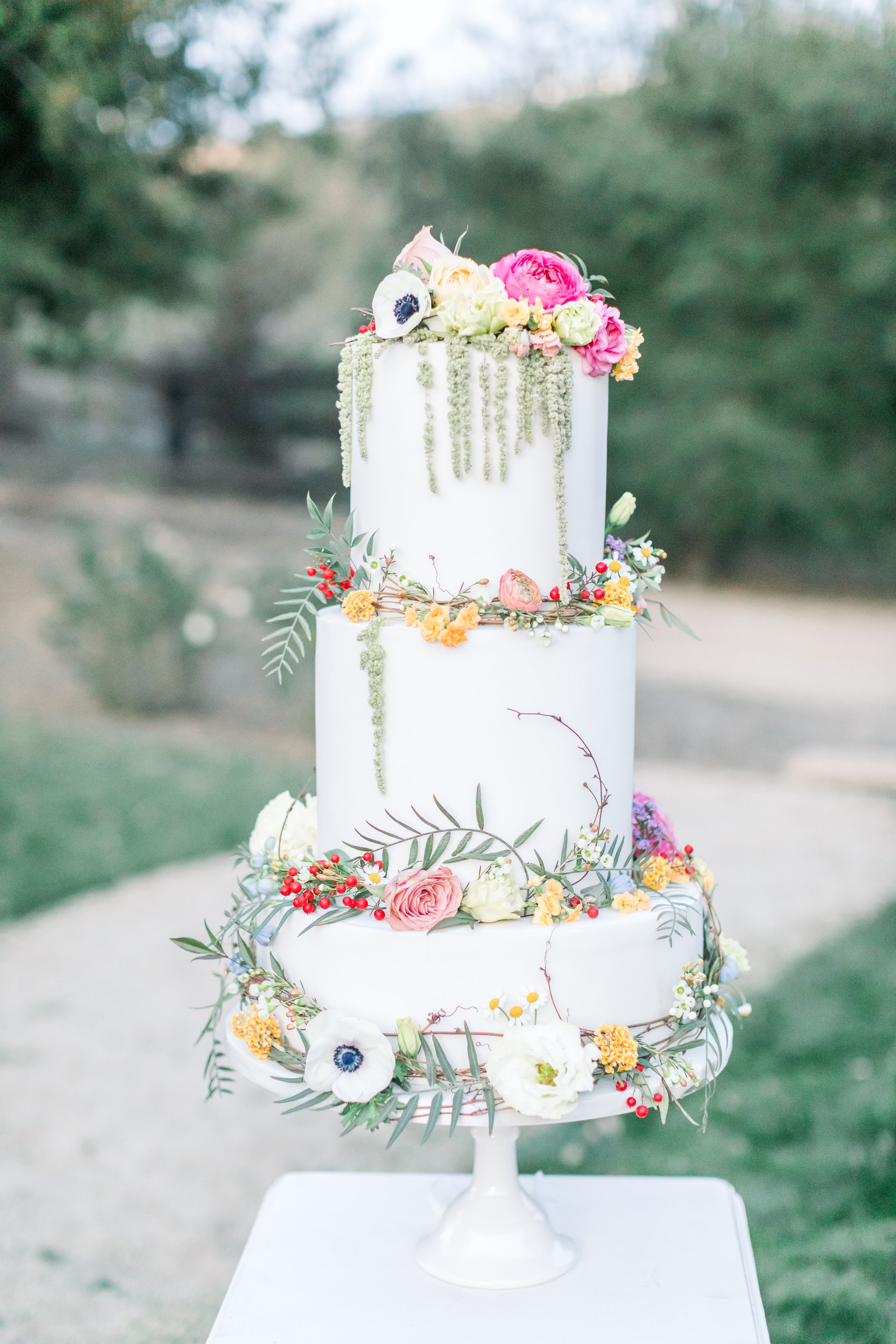 Wedding cake decorated with fresh flowers used at the Alice in Wonderland styled shoot in Murrieta.