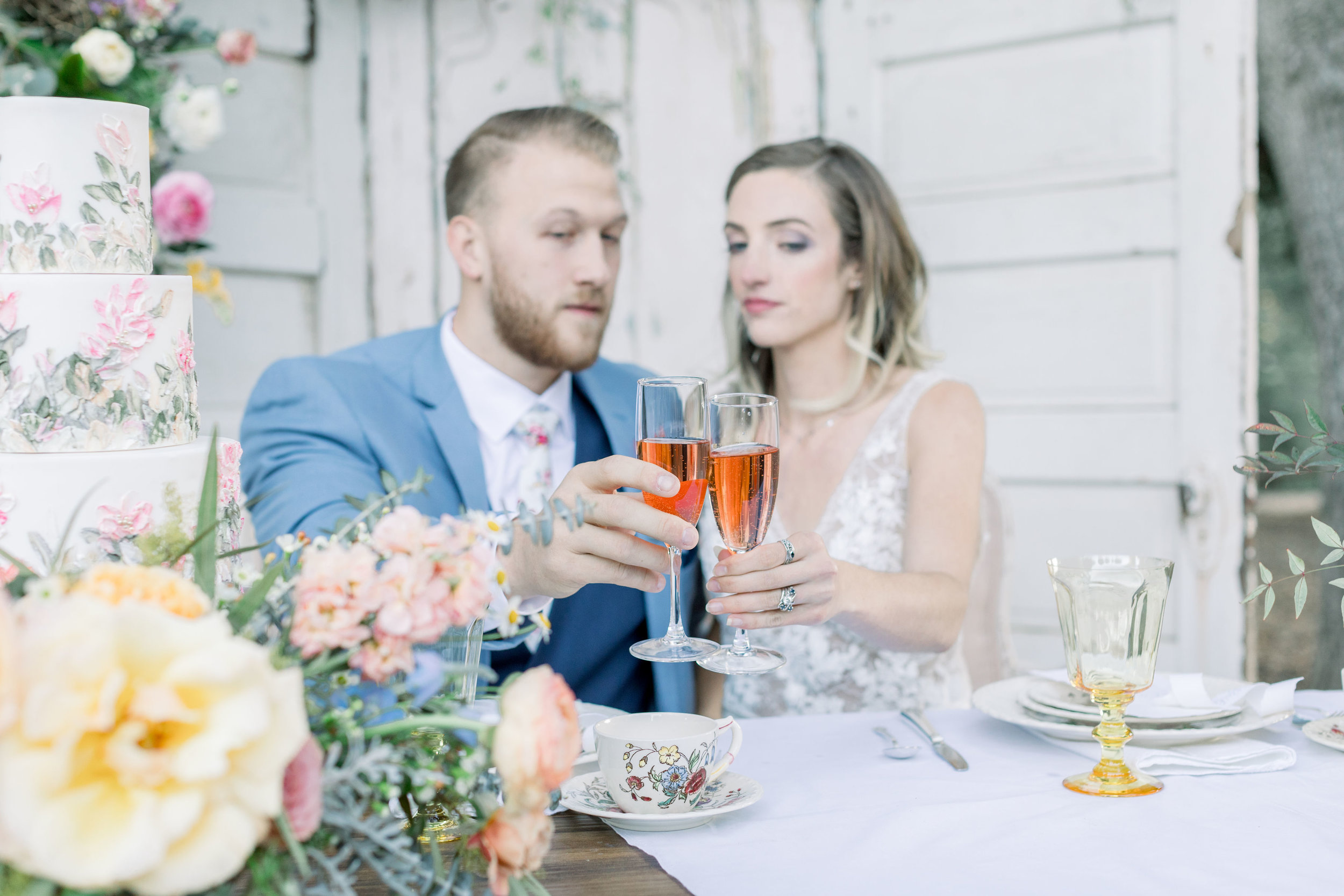The sweetheart table with the bride and groom toasting each other. Vintage china and crystal were used.