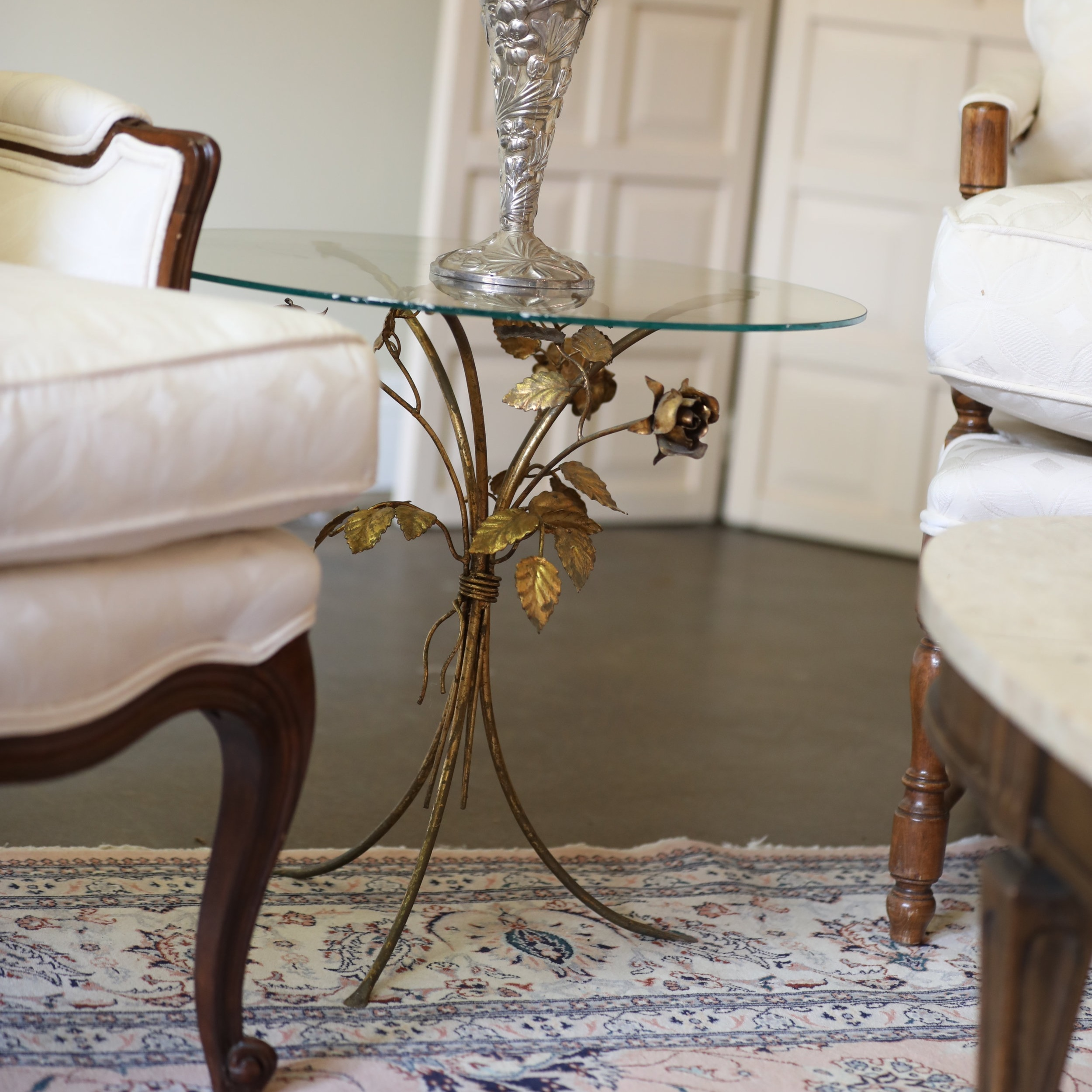 Rosie   Round glass side table with gold leafed gold roses base.
