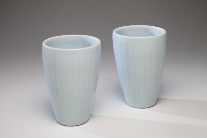 Porcelain striated beakers, 9cm high