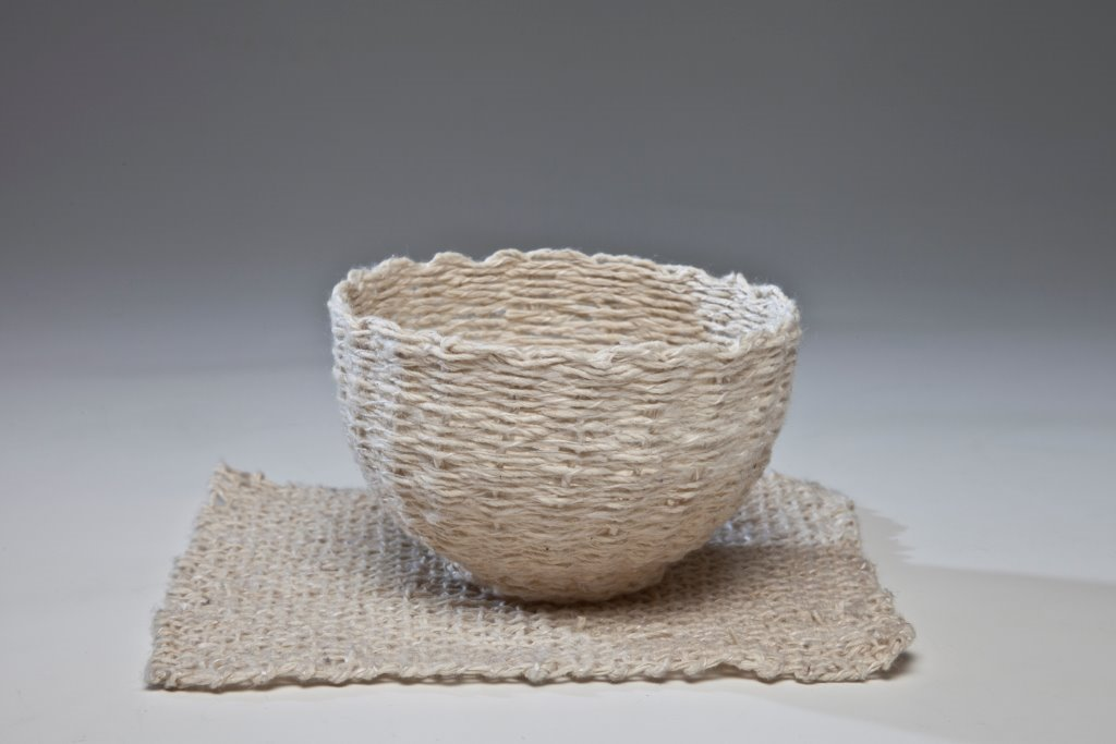 Paper cup with mat, 2013, Hand spun and woven Kozo paper fibre ply with silk, 5 x 14 x 12cm. Photo credit Uffe Schultze