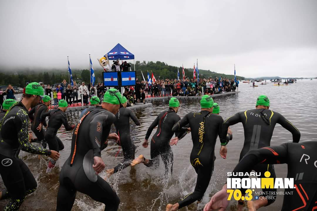 "Ironman 70.3 Mont. Tremblant swim start. I'm easy to spot with the ""sailfish"" wet suit."