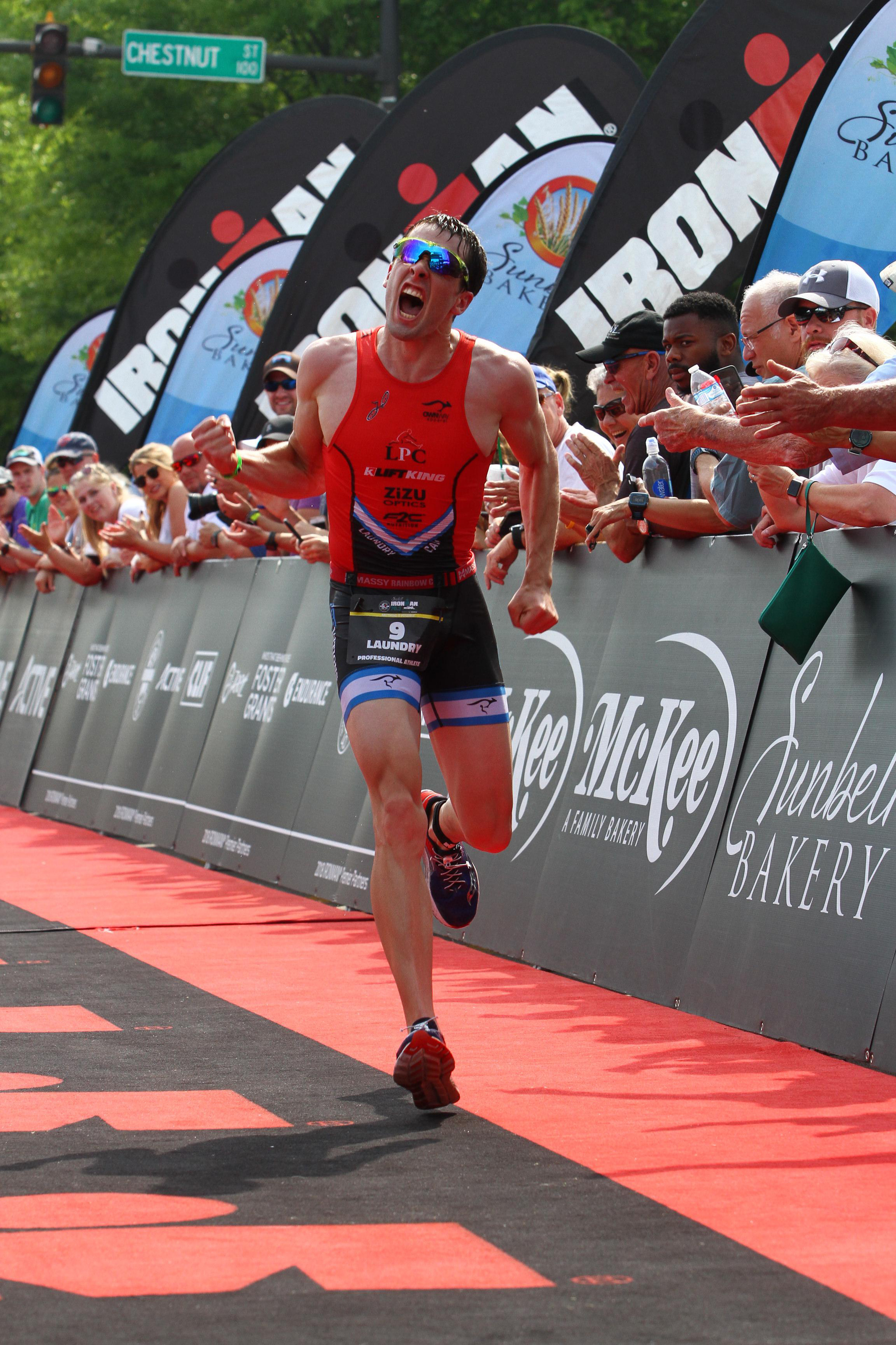 Coming down the finish chute at Ironman 70.3 Chattanooga. Photo by Finisher Pix