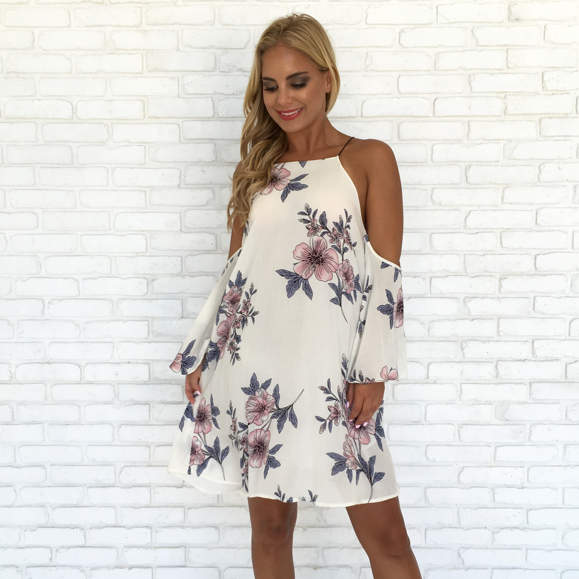 Here is another perfect short dress. I love the floral print. If you choose a dress with floral print though, try to select solid color outfits for everyone else in the photo. This dress would pair nicely with navy and pink! Shop this dress  here .
