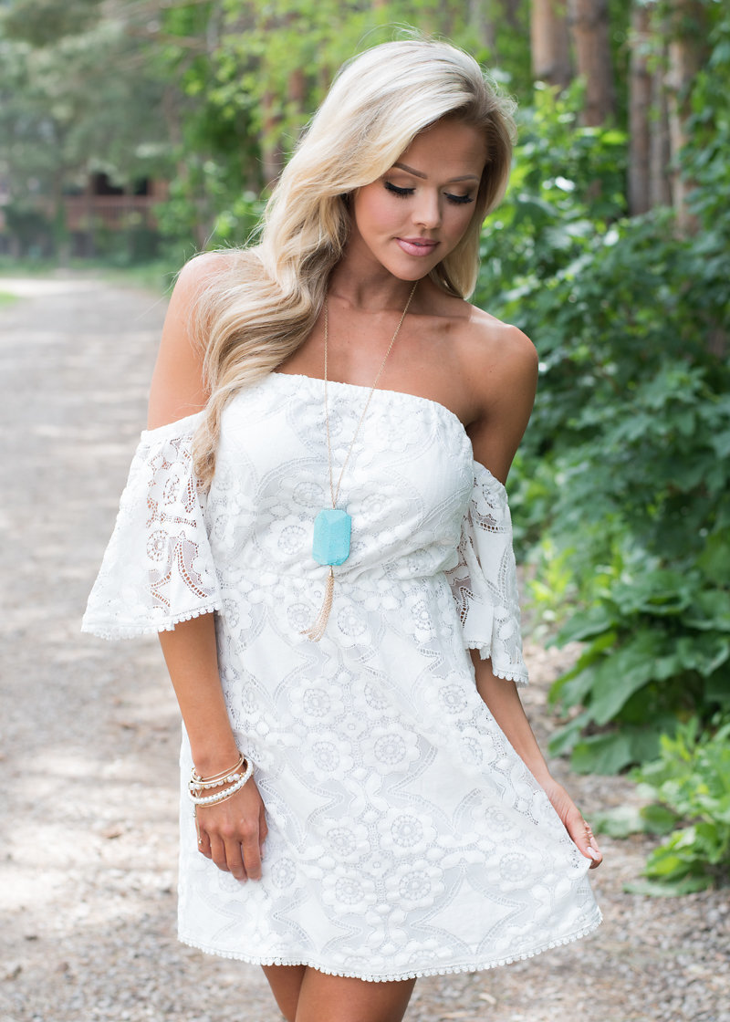 """White is such an """"innocent"""" color that goes with absolutely anything! Have a pair of cowgirl boots? White dresses go together with cowgirl boots like peanut butter and jelly. I personally love white dresses for couples shoots! Shop this dress  here ."""