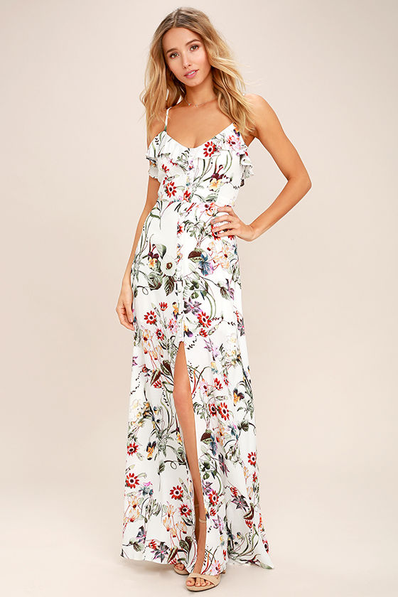 This floral print dress is so stunning! And there are so many colors on it, matching it with other outfits will be easy! You can find this dress  here .