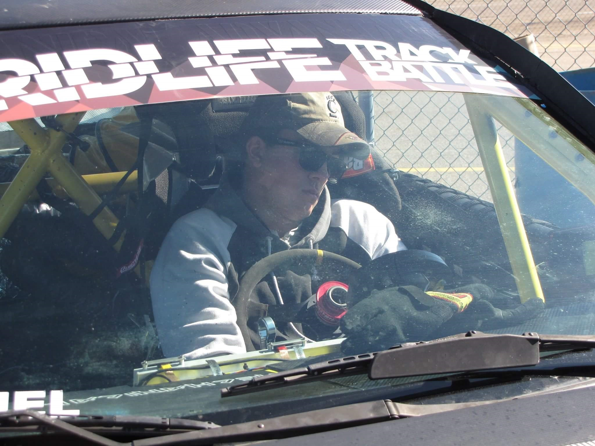 Grant getting steering wheel cuddles from his exhaustion as pit crew