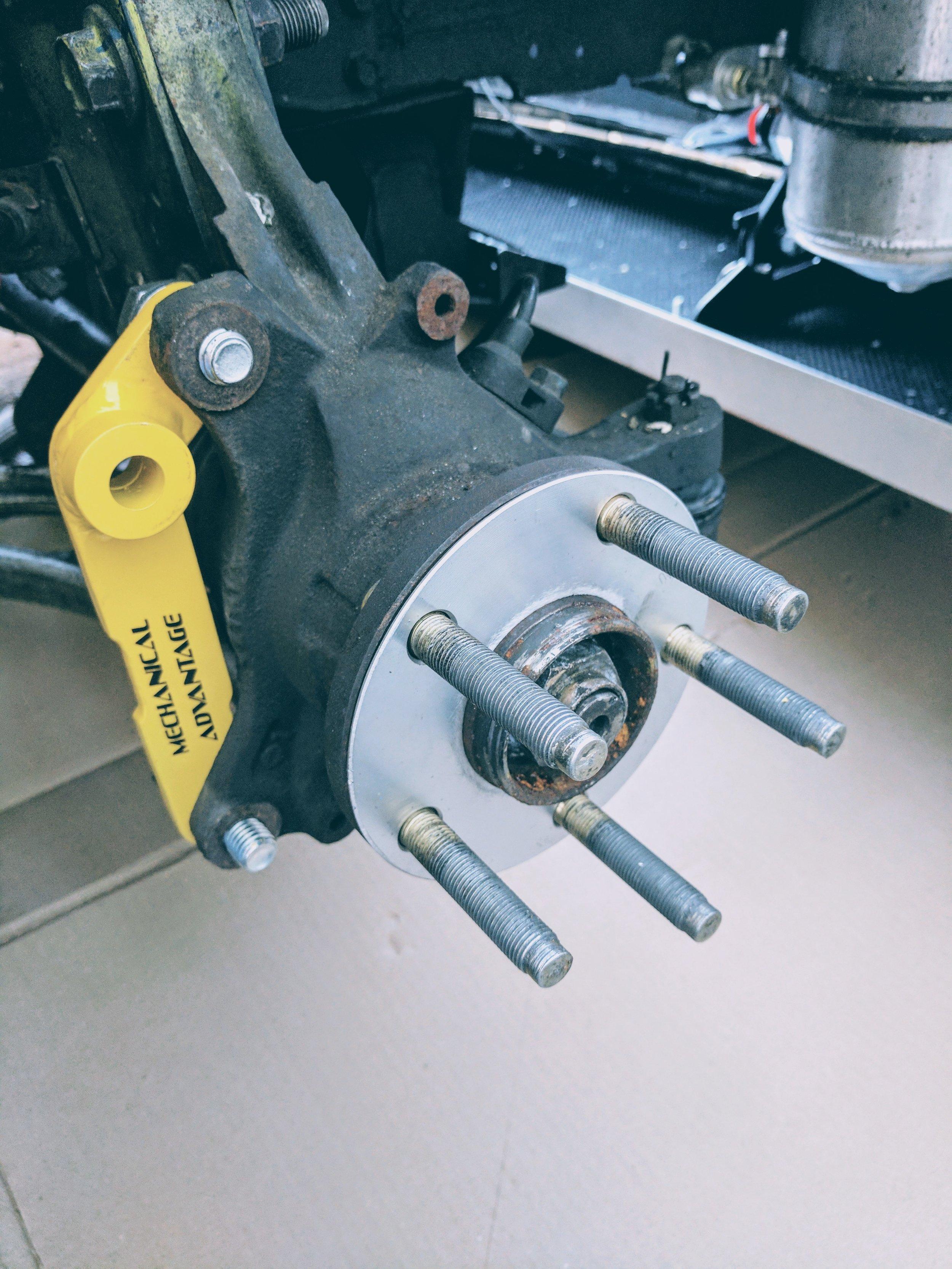 Caliper brackets installed