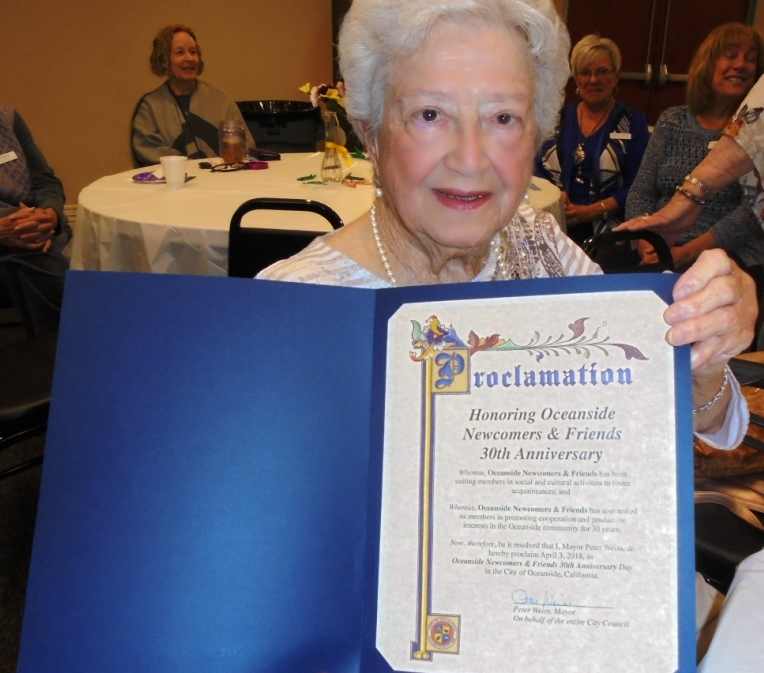 Oceanside Newcomers & Friends founder and past president 1989-1990, Mimi Howland holding the City of Oceanside Proclamation that April 3, 2018 has been designated Oceanside Newcomers & Friends 30th Anniversary Day. The proclamation was signed by Mayor Peter Weiss and was presented to our group by Deputy Mayor Chuck Lowery.