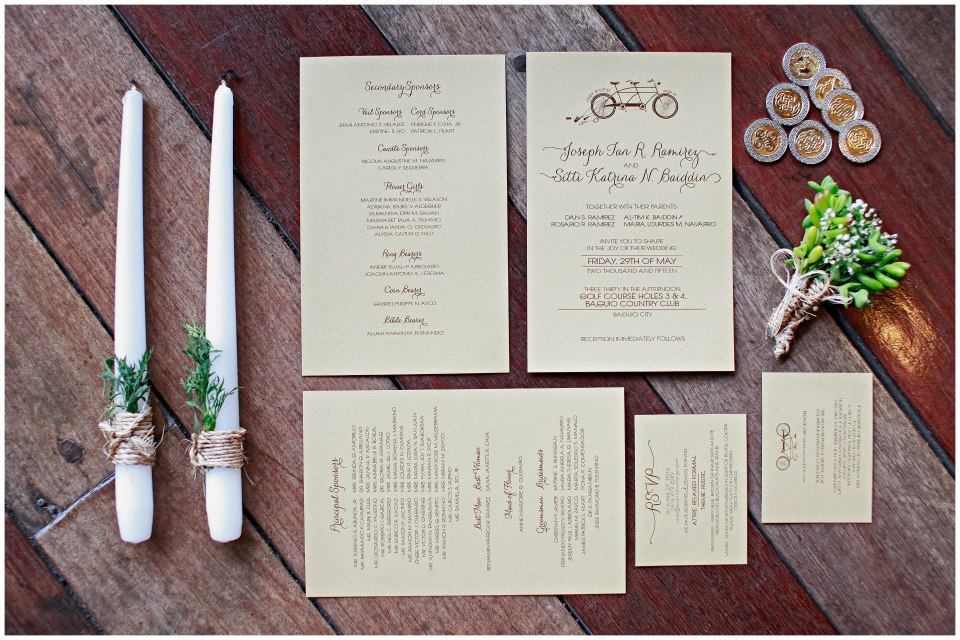 Julienne Styling suggested that we tie our invitations up with abaca yarn and eucalyptus leaves - all our invites smelled so good. <3