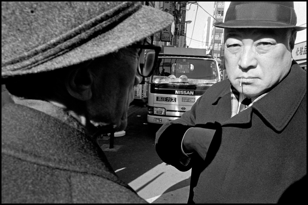 JAPAN. Tokyo. Kaeda. Business man at lunchtime outside JR station. 1996.