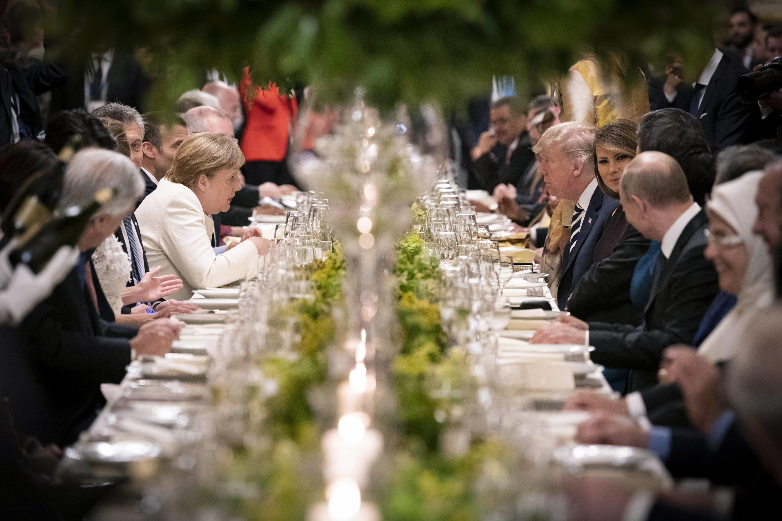 В центрі - федеральна канцлерка Німеччини Ангела Меркель, президент США Дональд Трамп, перша леді США Меланія Трамп  Fortune