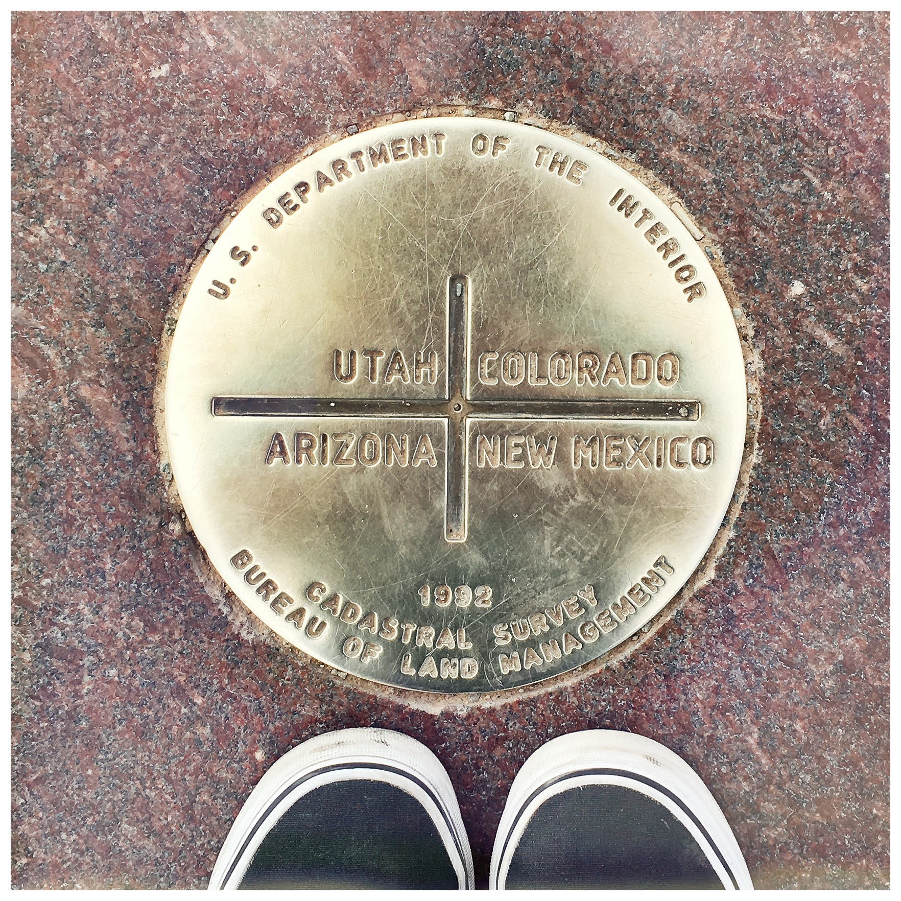 Smaller than my feet - The Four Corners Monument itself.