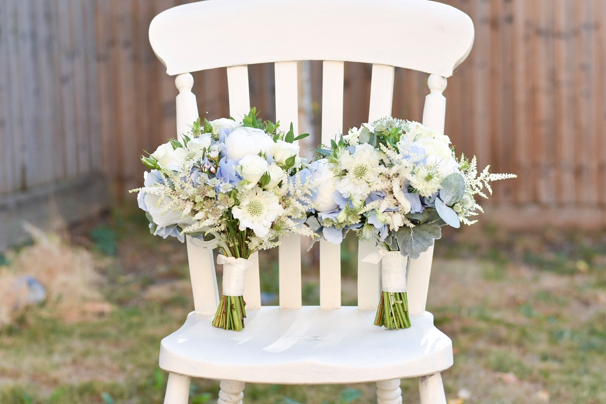 Blue and white bouquets with peonies on white wooden chair
