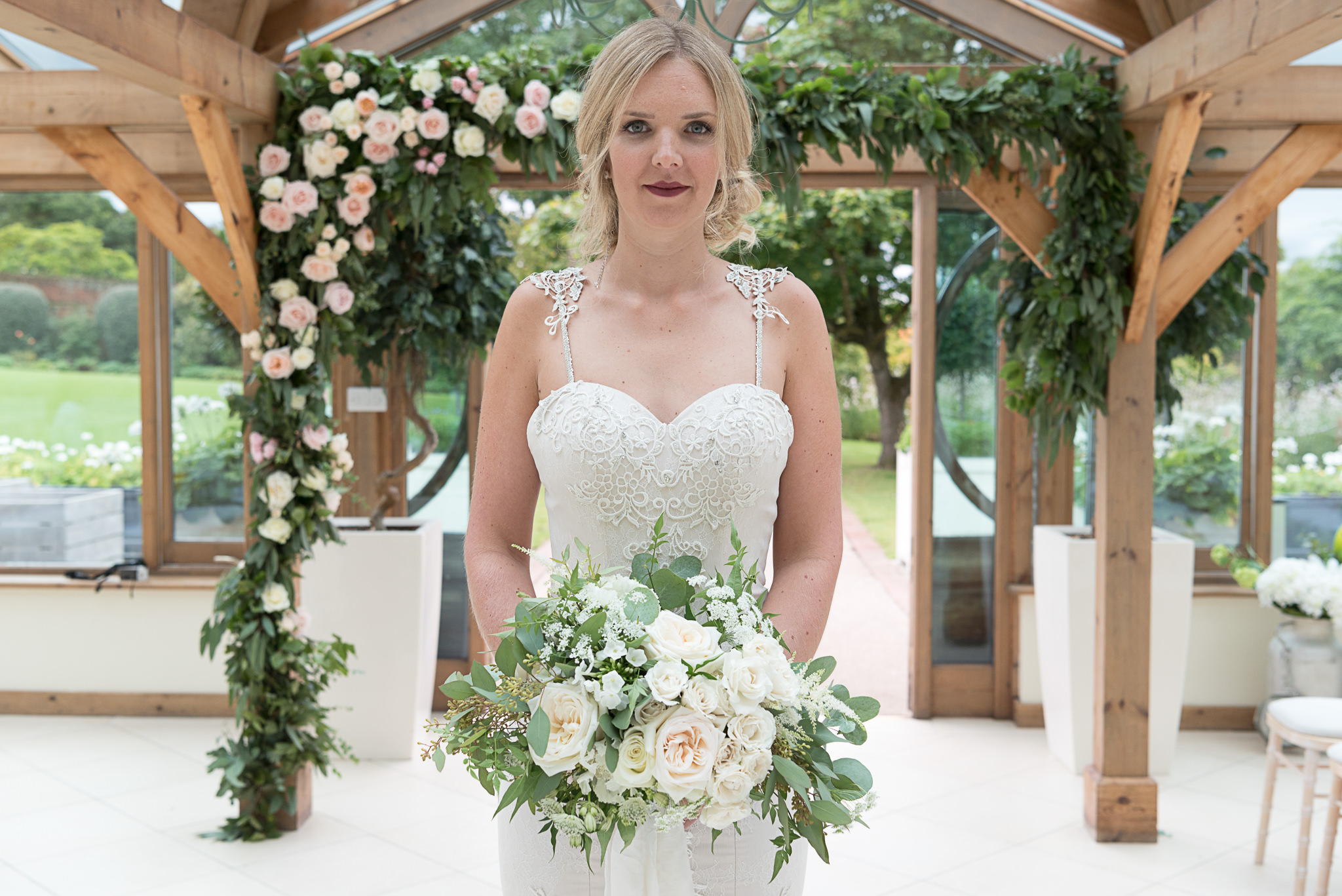 Modern English Rose Bride,  Flowers by Petal and Wild, bride in front of floral arch 1 image by Victoria Murray Photography_mini.jpg