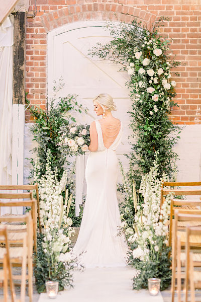 Wedding arch by Petal and Wild for the Railway Barn Essex_opt.jpg