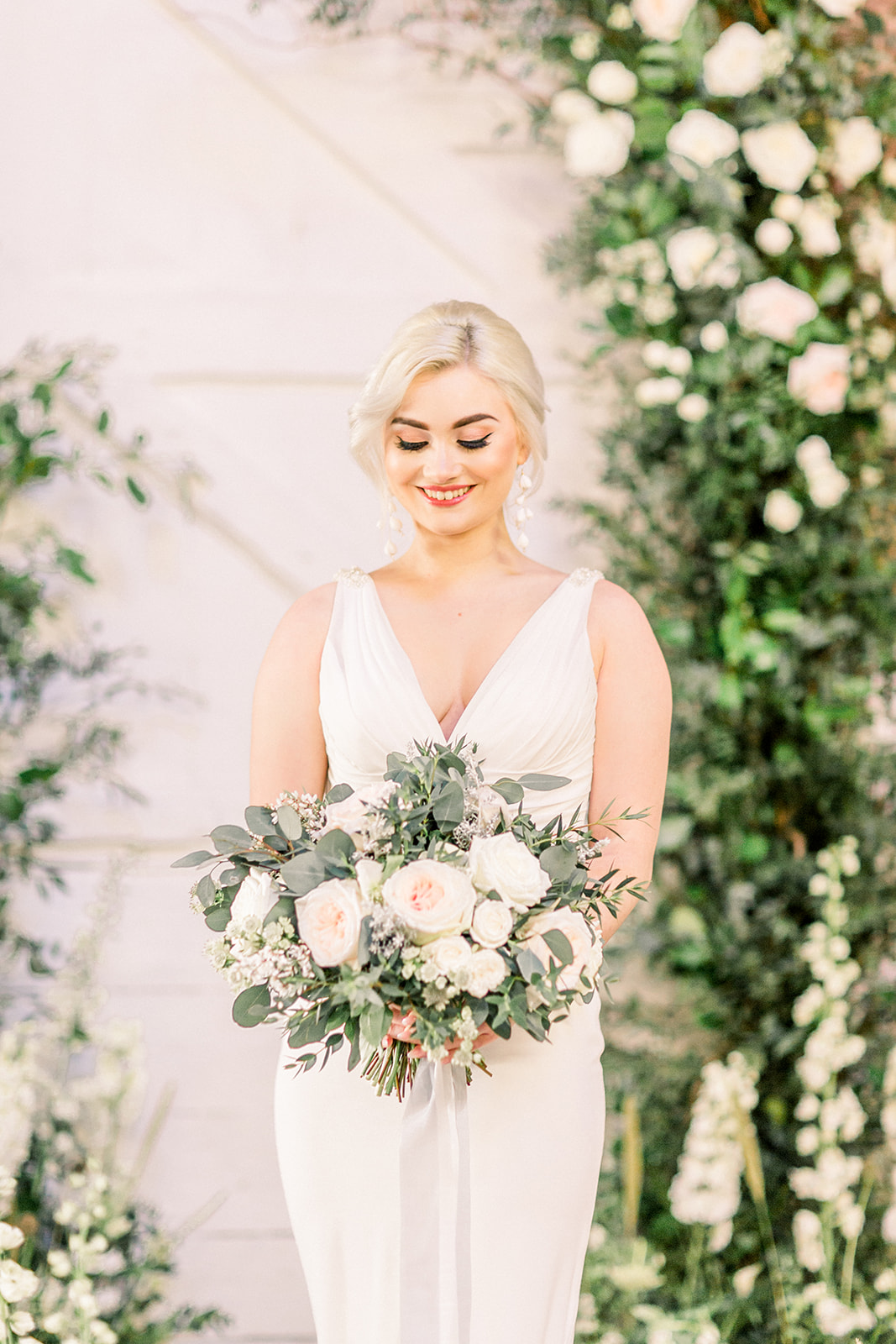 Floral arch and bridal bouquet by Petal and Wild at The Railway Barn.jpg