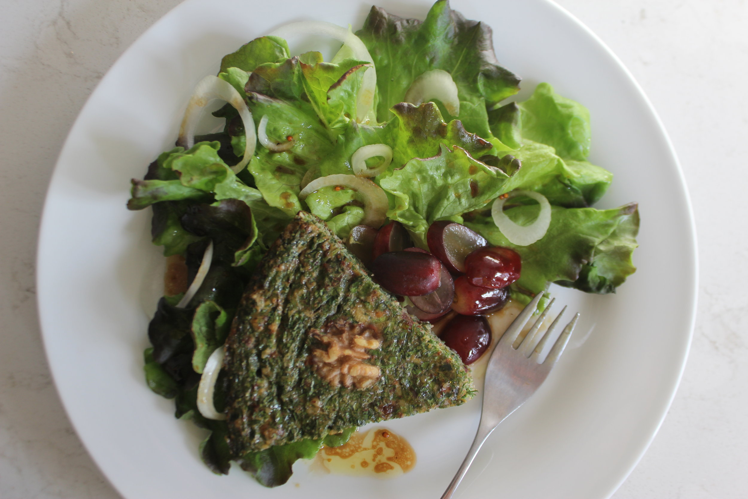 Baked Kuku Sabzi with Greens and Pomegranate Molasses Vinaigrette