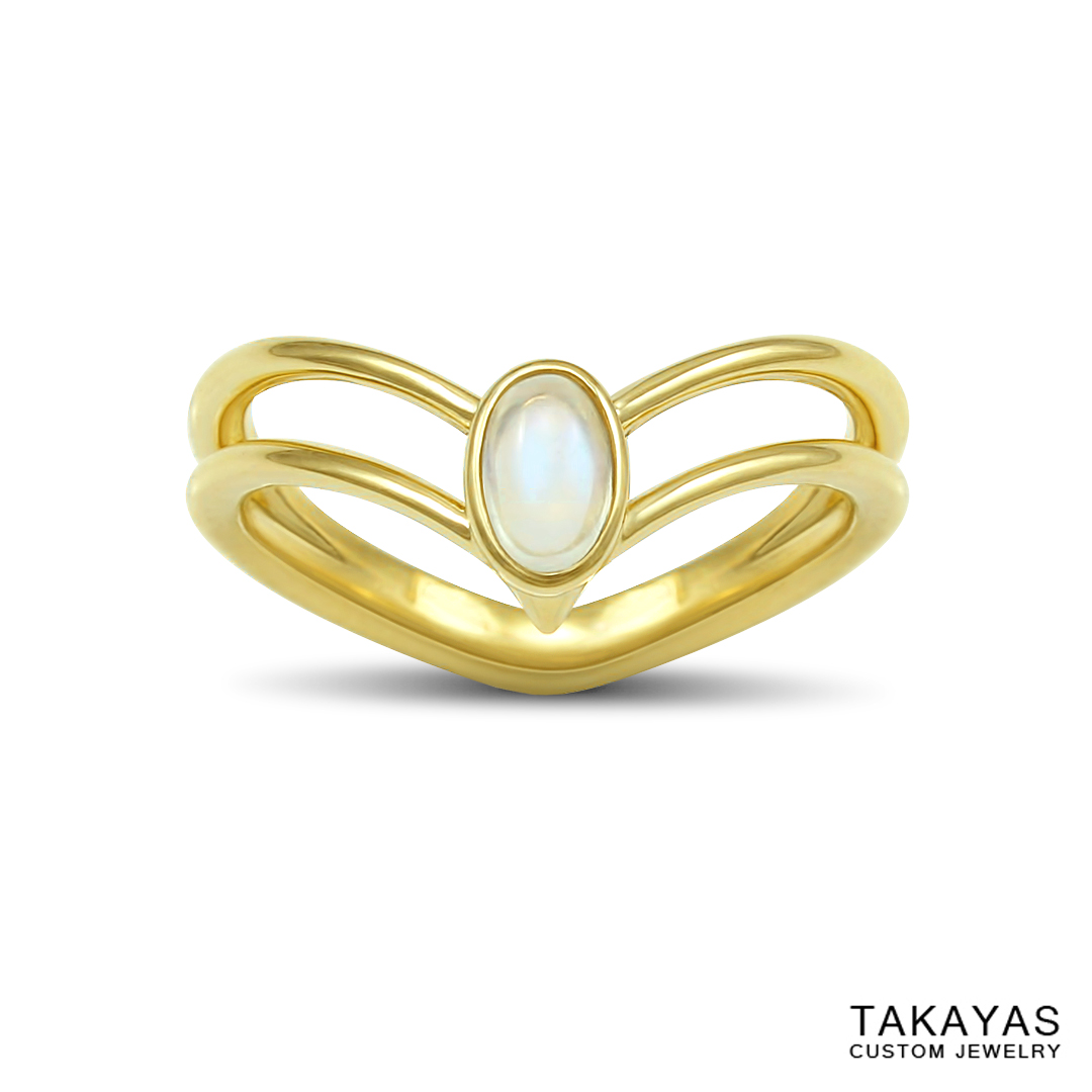 Front view of 14K yellow gold and moonstone Sailor Saturn engagement ring by Takayas Custom Jewelry