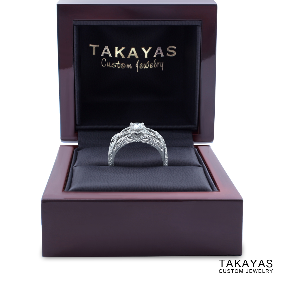 Custom 14K white gold and diamond engagement ring with elegant fantasy elements by Takayas