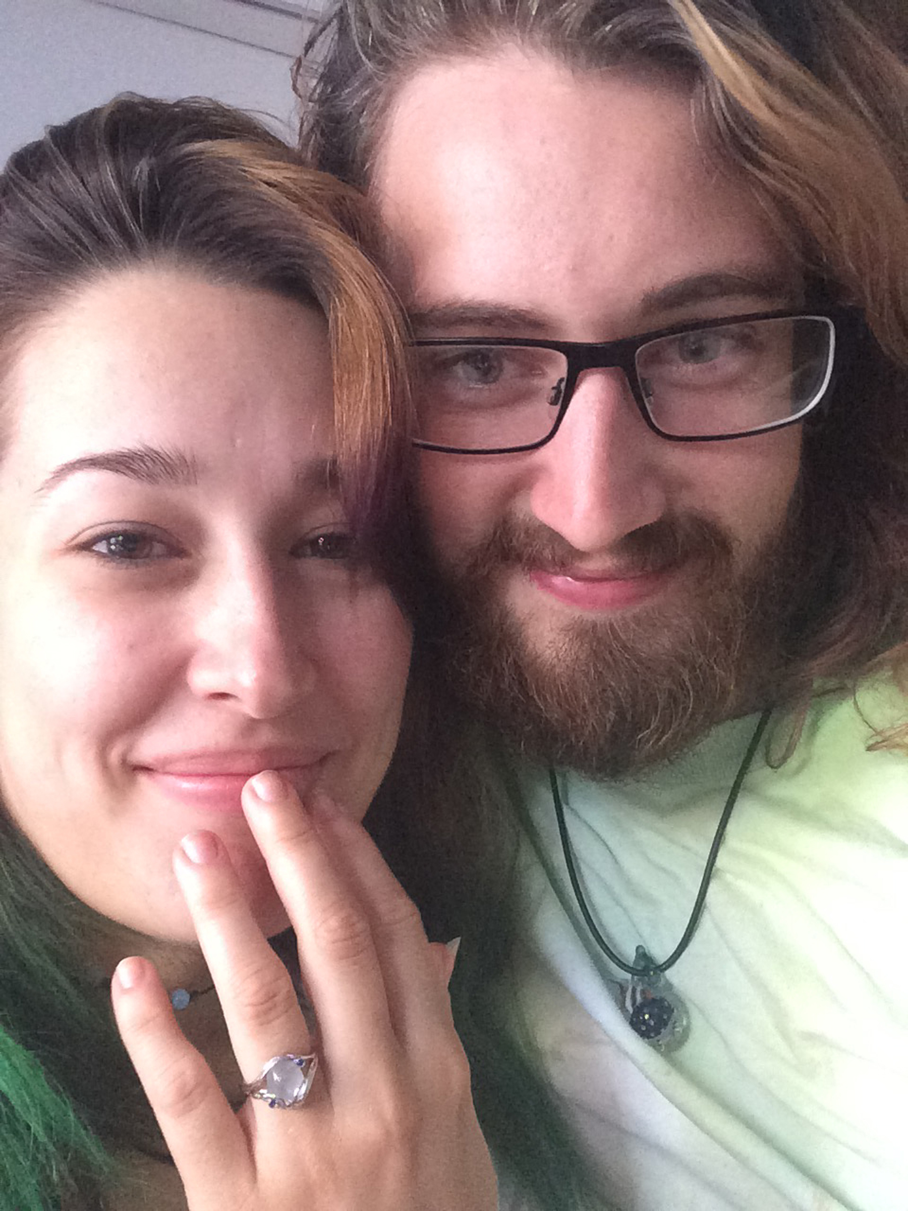 Alice and Michael together, showing off their custom Elvish Moonstone Engagement Ring by Takayas
