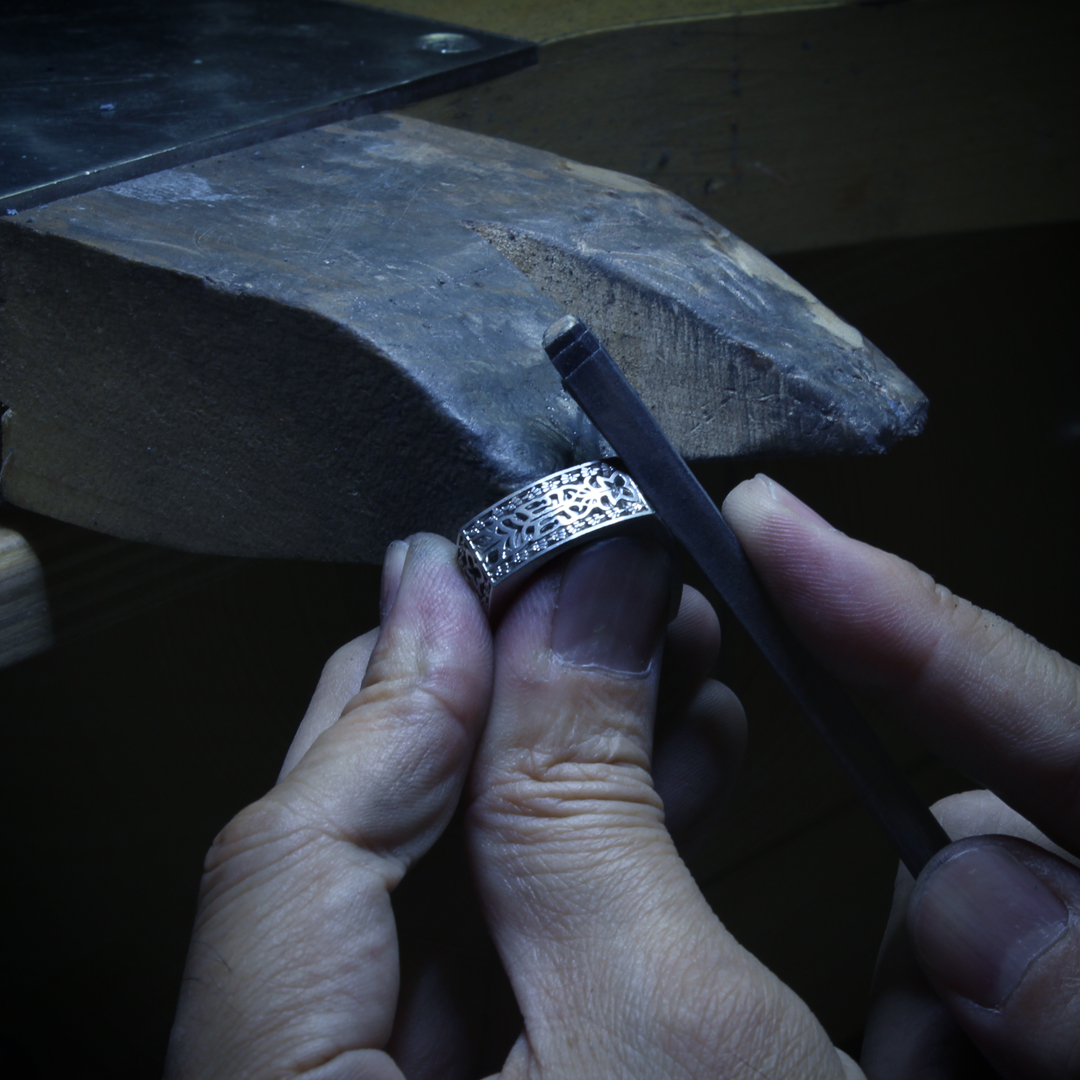 Takayas at the bench, working on the custom Aztec Initials Wedding Ring
