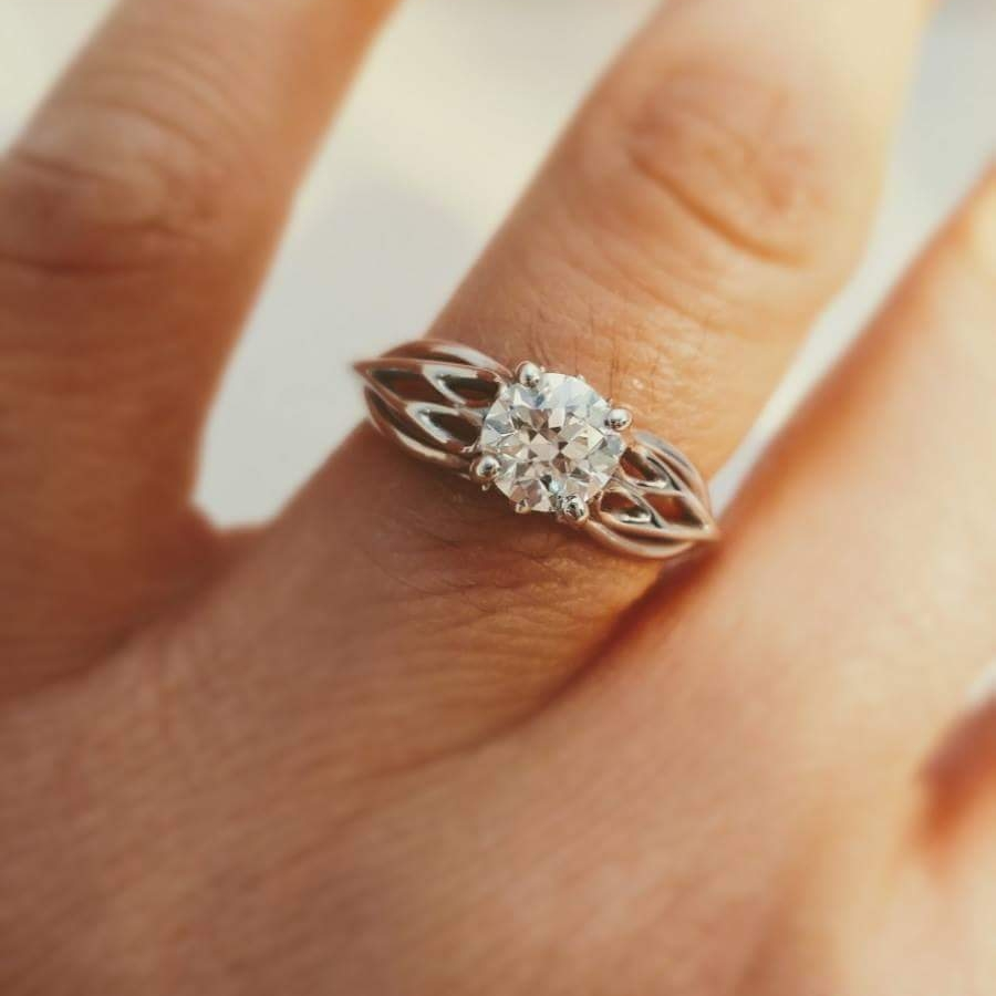 Joys_Ring_solitaire_engagement_ring_by_Takayas_on_her_finger.jpeg