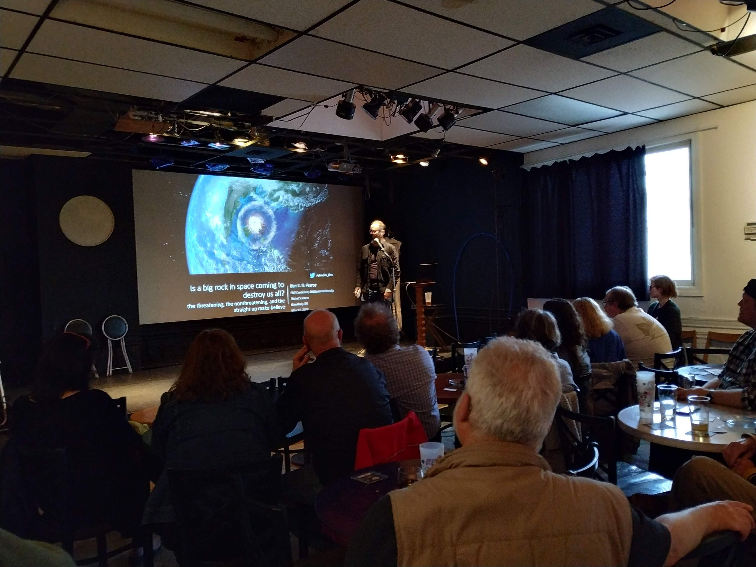 Pint of Science 2019:  Ben K. D. Pearce giving an outreach talk on the potential threat of big space rocks on human existence. Artword Artbar, Hamilton, May 22nd, 2019.  Photo credit: Thanassis Psaltis.