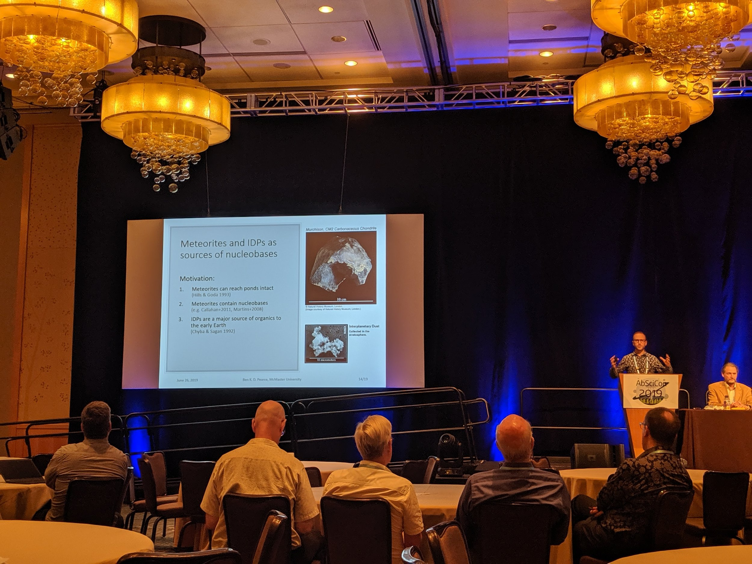 Astrobiology Science Conference (AbSciCon) 2019 : Ben K. D. Pearce giving an invited talk on meteorites and interplanetary dust particles as sources of nucleobases to warm little ponds on the early Earth. Bellevue, WA, June 26th, 2019.  Photo credit: Andrew Tupper.