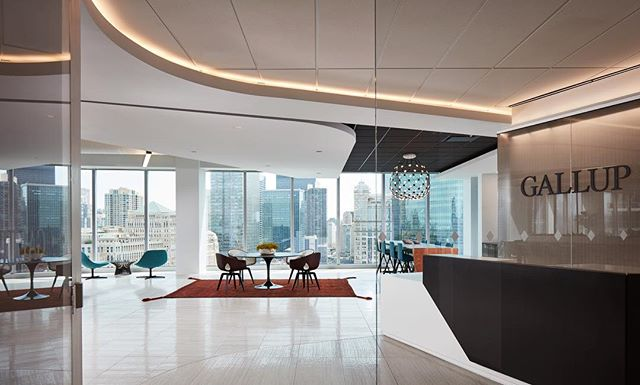 Wow. Look at those curved soffits and light coves… the view's not bad either!😉 Proud of the custom build-out we did with @clunegc for the data-driven research firm, Gallup Organization. The 13,000 sf modern design included all glass offices, specialty barn doors, and a folding wall that disappears into the ceiling. . . . #AlignedWithYou #alliancedrywall #alliancecarpentry #allianceacoustical #interiors #dreamoffice #ccboffice