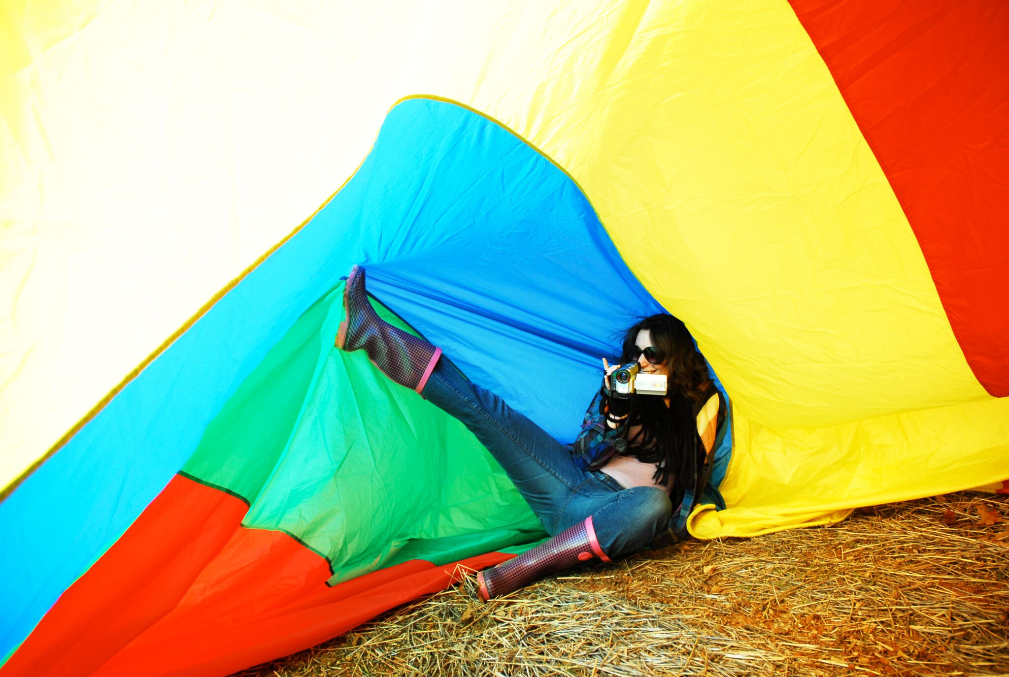 Look at me multitasking and being flexible! Shooting a  video  while holding up a rainbow tarp with my foot.   Photo by    Melissa Madison Fuller