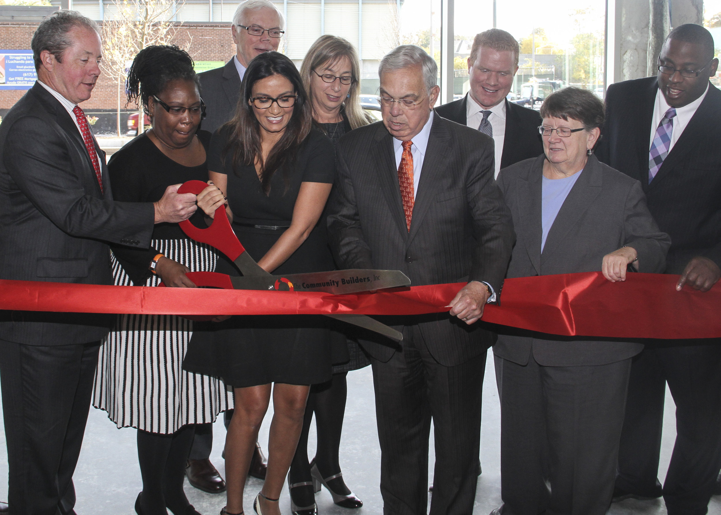 Boston Mayor Thomas Menino, center, takes part in the ribbon cutting with, from left, Bart Mitchell of the Community Builders, Chrystal Kornegay of Urban Edge, HIT's Tom O'Malley, 225 Centre resident Ana Durate, HUD's Barbara Fields, Boston City Councilor Matt O'Malley, State Rep. Elizabeth Malia, and Boston City Councilor Tito Jackson