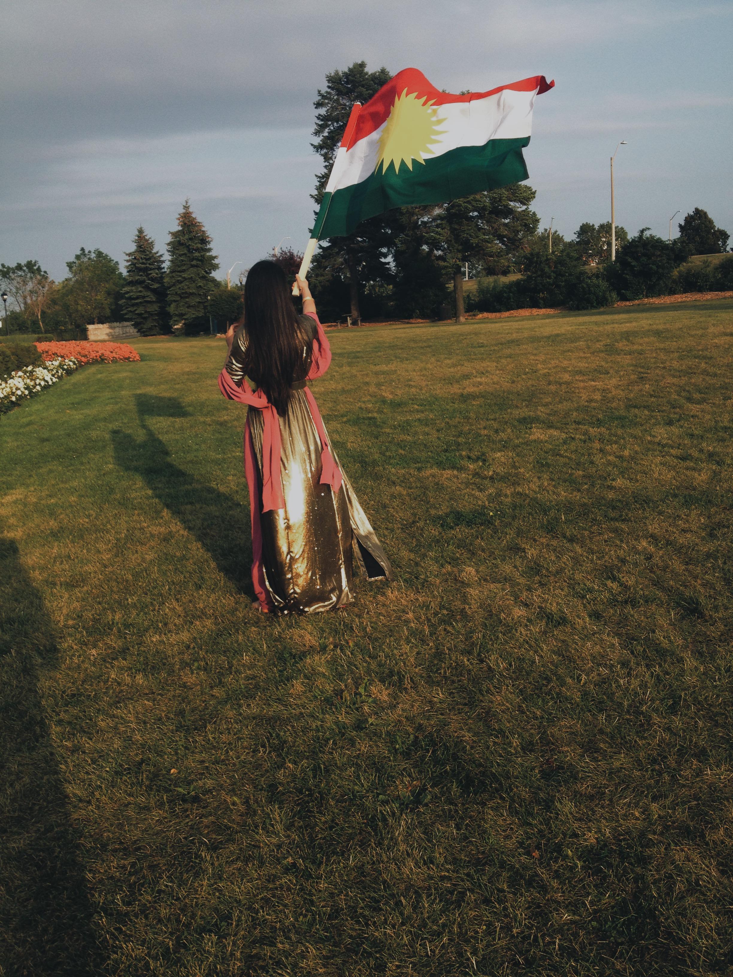Me with Ala Kurdistanê (The Kurdistan Flag)