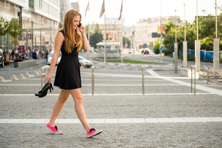 35897542_S_woman_walking_strolling_sneakers.jpg