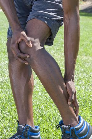 32055108_S_Achilles_pain_man_fit_runner_sneakers_grass_heel.jpg