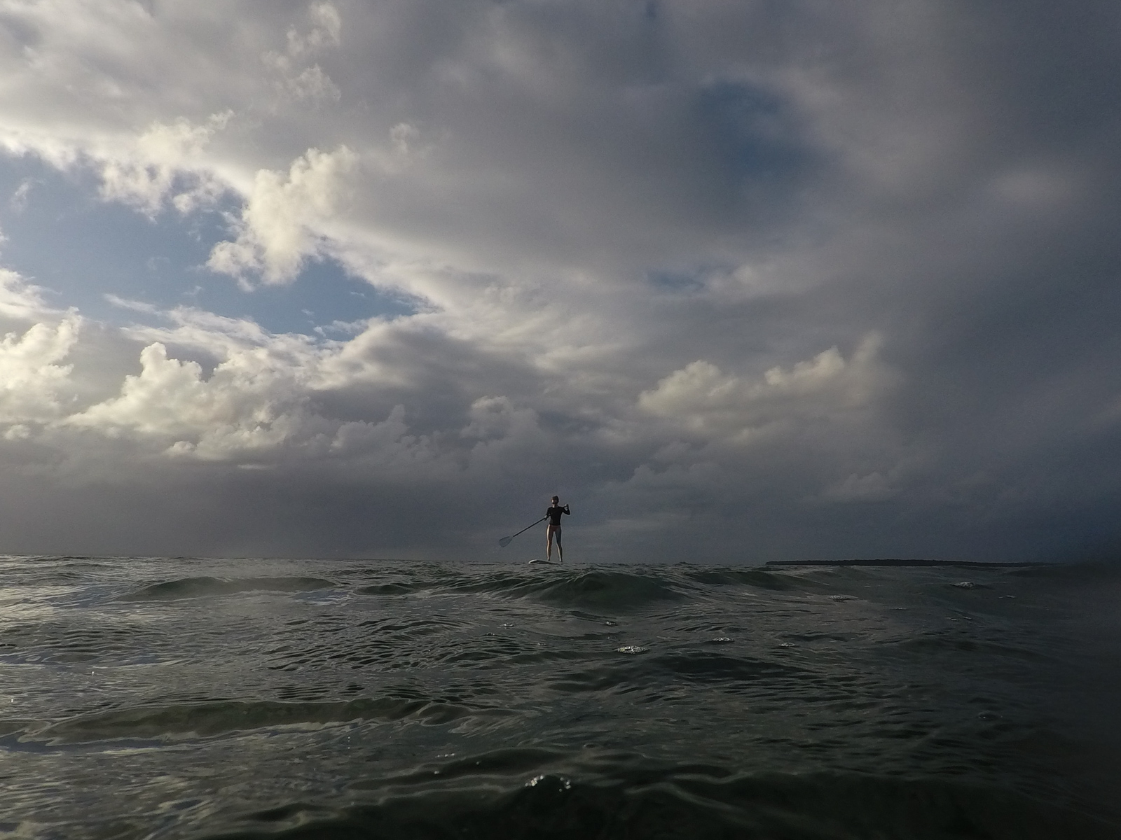 Stephanie took out the SUP and caught some amazing late afternoon light against distant stormy skies.