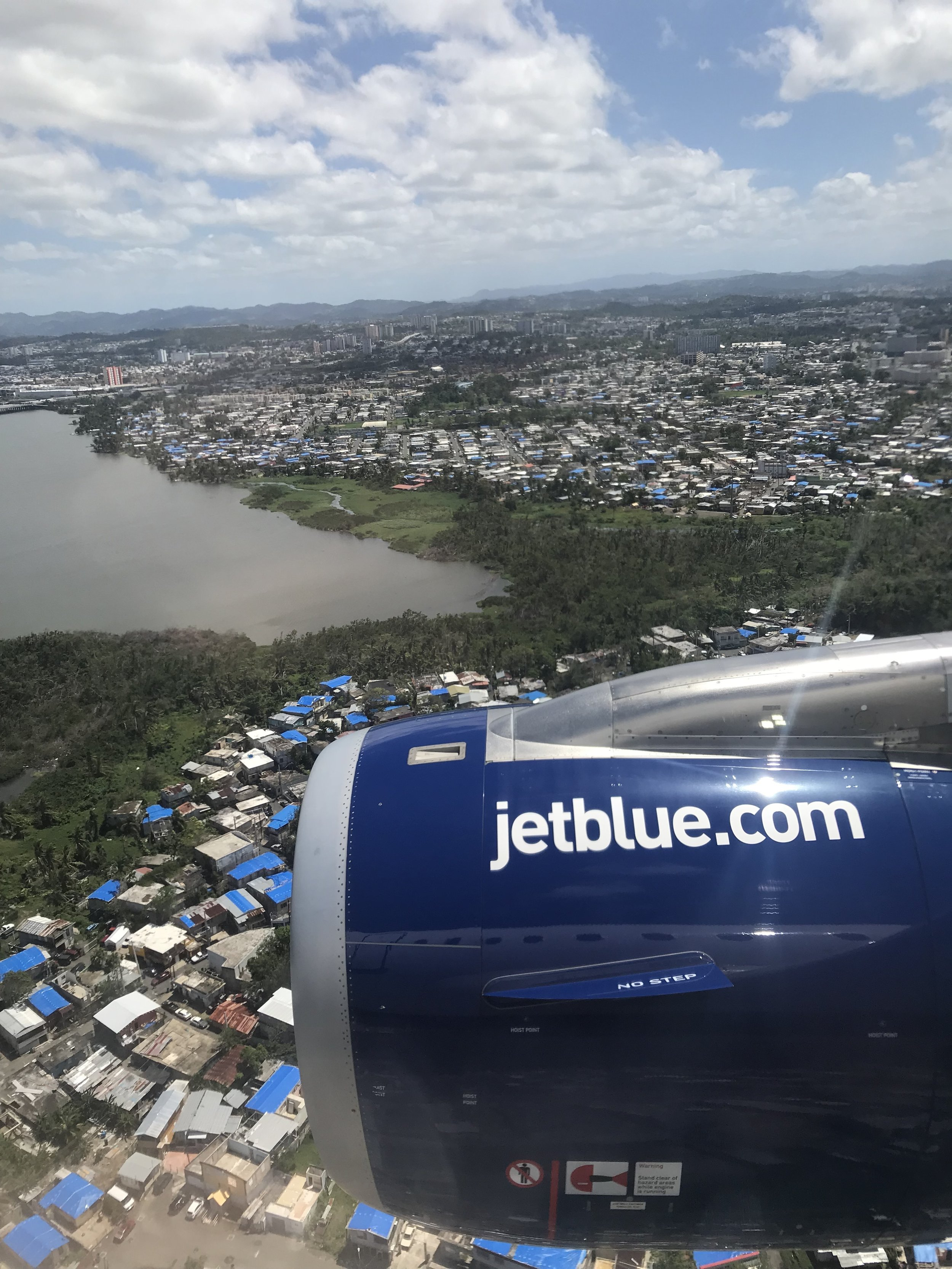 Blue tarps on San Juan roof tops, scars of Hurricane Maria.