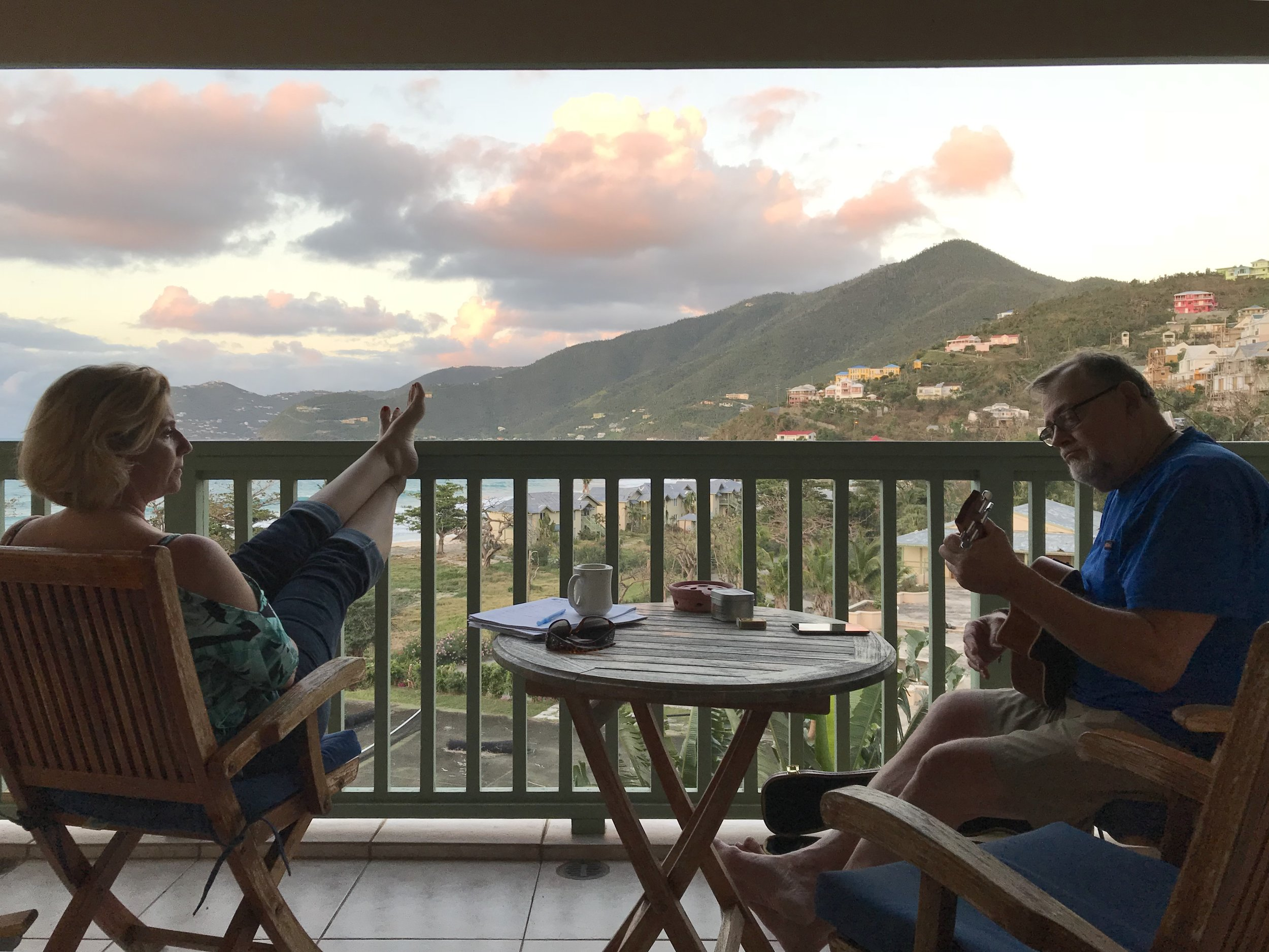Miriam and Bob taking a little time for music on our balcony. The view, the skies, the sea here, just as beautiful as ever.