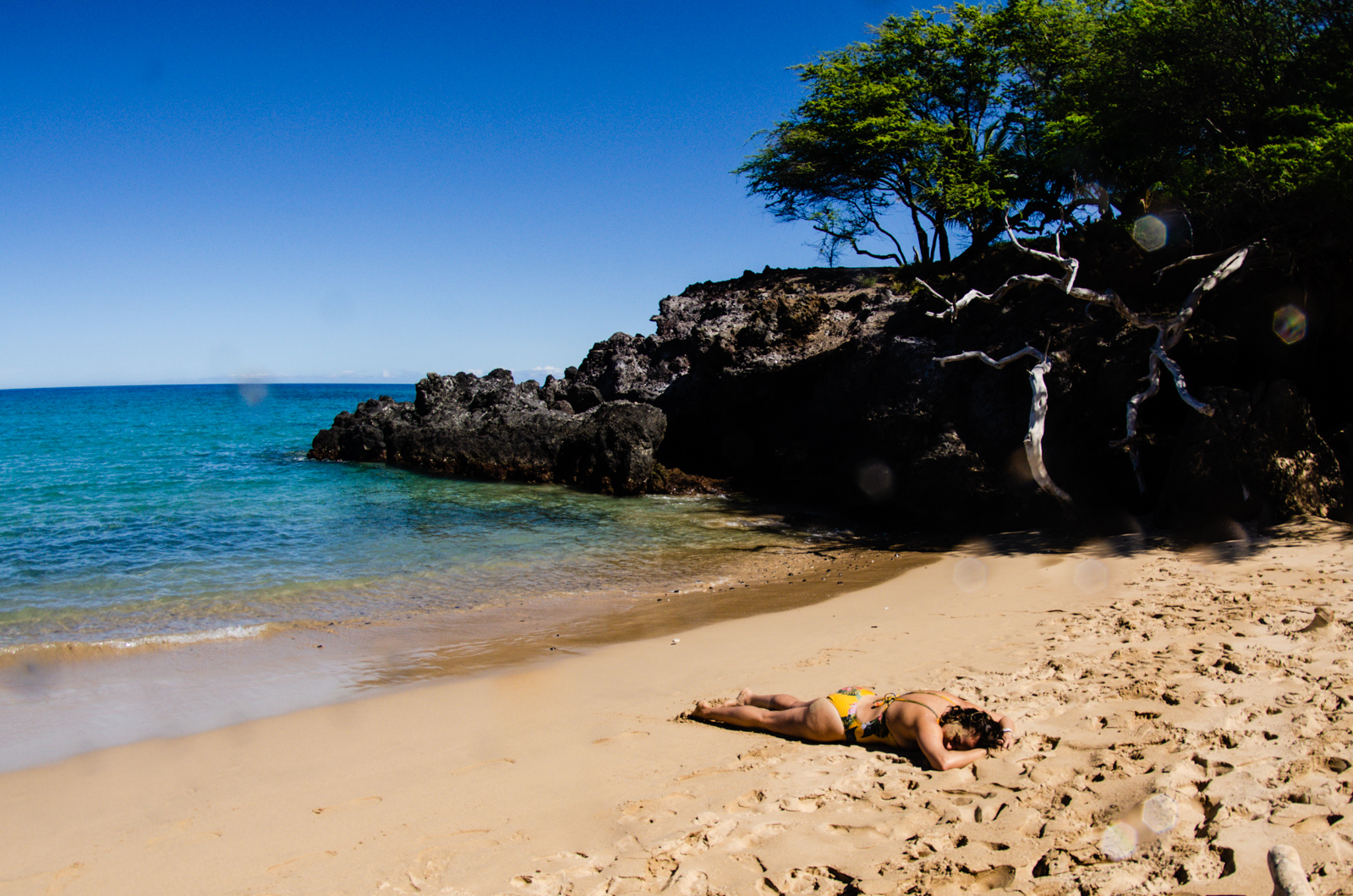 Yafa relaxes in the sand after our beautiful morning swim.
