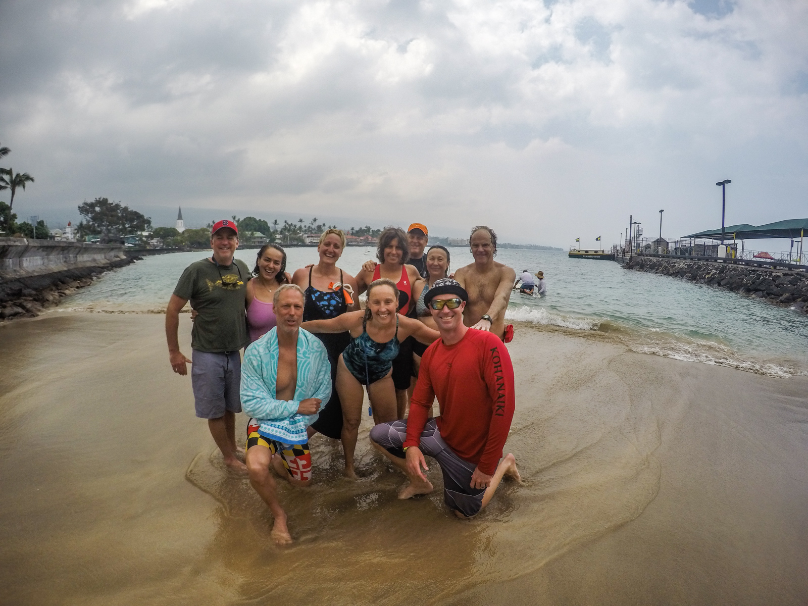Team SwimVacation completes the swim leg of the IronMan! Next up, showers on the pier and shave ice.