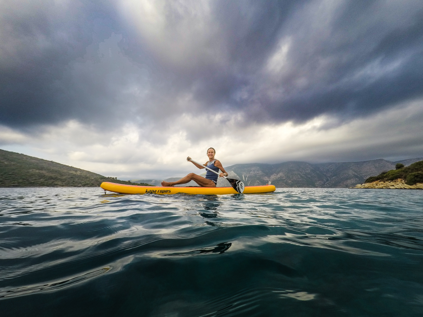 """Marina took the bay by SUP, stopping to chat with few local fisherman who reported the fish were being """"sneaky""""."""