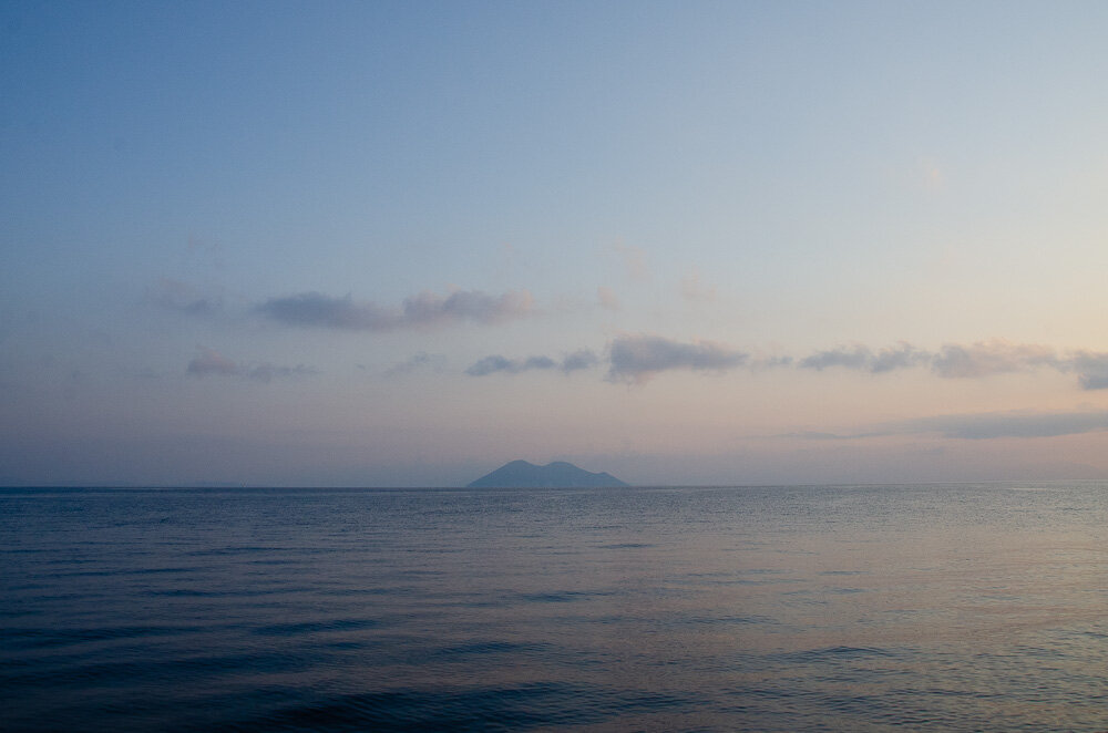 I woke late, past the best of the sunrise. But the sky was still soft with pinks and blues in the waters beyond Gidaki beach where we spent the night.