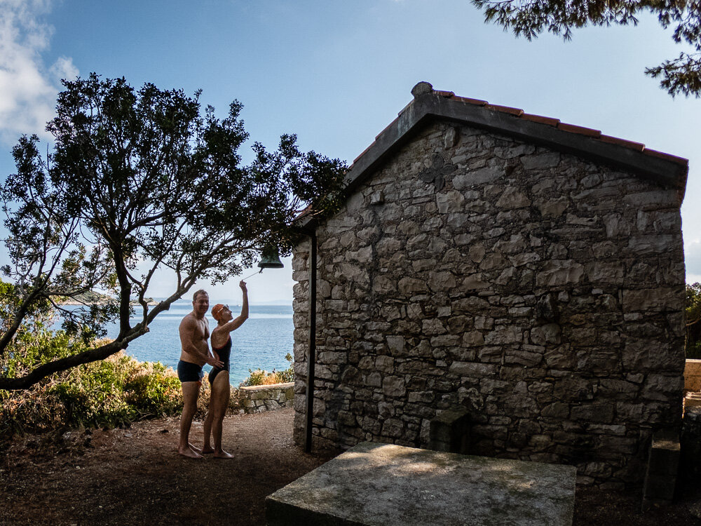 Ringing the bell on the chapel of the tiny island of Nikolou for good luck.