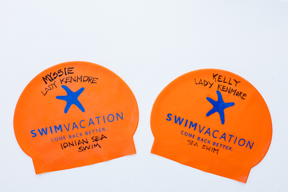 On arrival, Myssie and Kelly labeled their caps with their titles from decades ago.