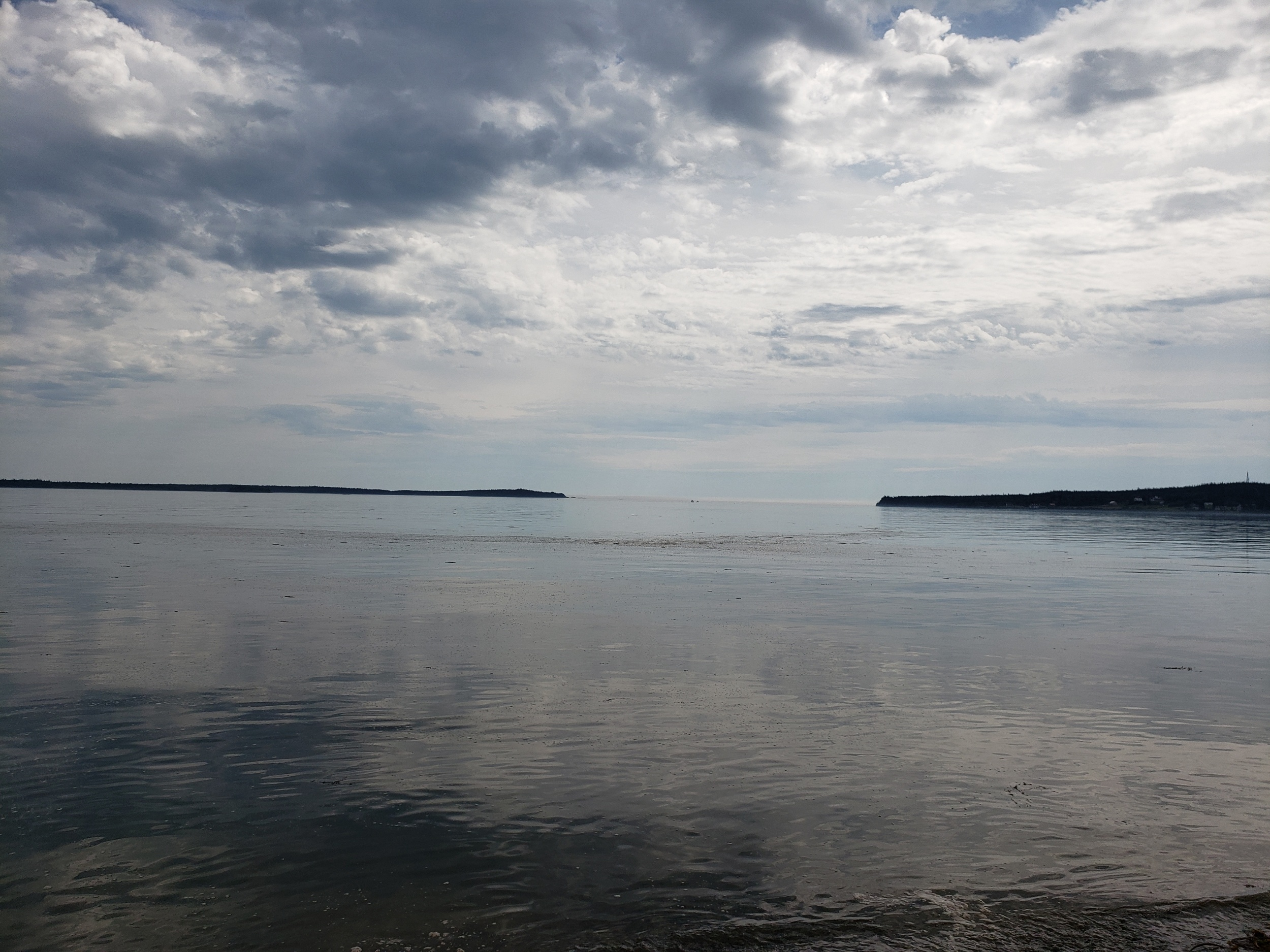 View from beach in South Lubec looking out onto Quoddy Head State Park to the right and Campobello Island to the left