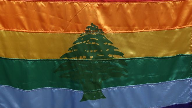The gay pride/flag of Lebanon waives during a protest inside Beirut in 2013 (AFP/FILE)